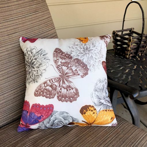 natural butterfly pillow on chair