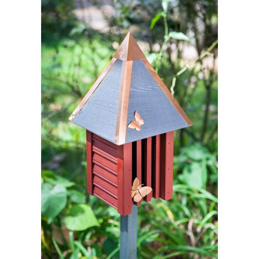 Butterfly houses pictured in garden